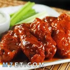 طريقة عمل أجنحة الدجاج بالبصل