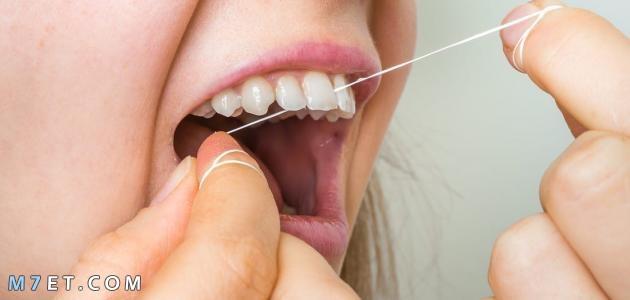 كيف استخدم خيط الاسنان